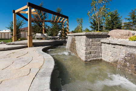 0093-winnipeg-back-yard-pergola-flag-stone-water-features-planters-pisa-landscaping-min