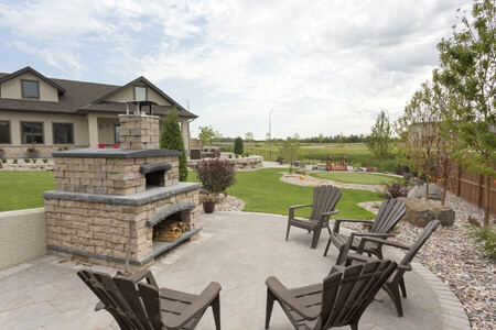 0112-a-winnipeg-back-yard-outdoor-fireplace-flag-stone-patio-landscaping-min